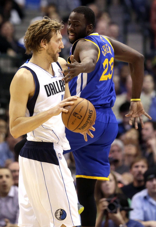 Photo - Dallas Mavericks power forward Dirk Nowitzki (41) of Germany is defended by Golden State Warriors small forward Draymond Green (23)during the first quarter of an NBA basketball game Saturday, Feb. 9, 2013, in Dallas. (AP Photo/LM Otero)