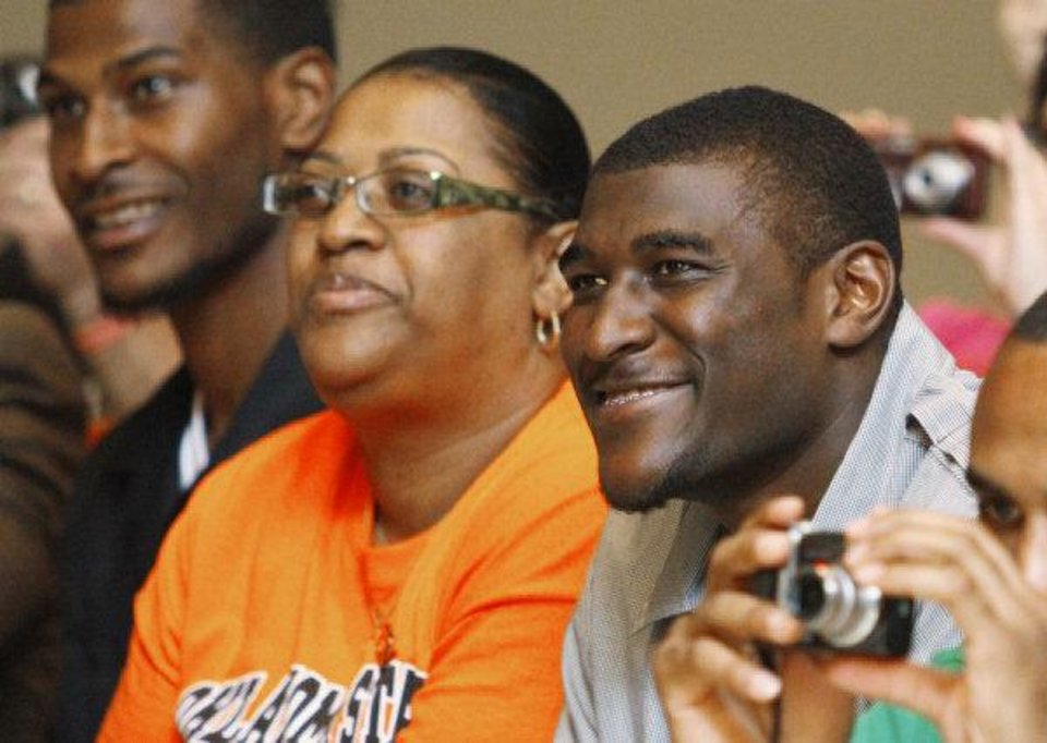Justin Blackmon (right) listens to speakers with his mother Donna and brother Warren Blackmon Jr. during Justin Blackmon Day in Ardmore, Oklahoma, on Saturday, April 23, 2011, in Ardmore, Okla. Photo by Steve Sisney, The Oklahoman <strong>STEVE SISNEY</strong>