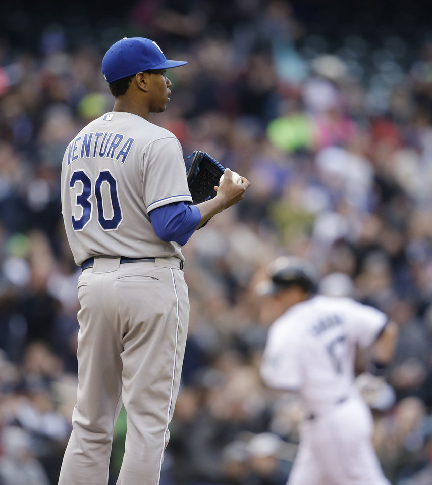 Photo - Kansas City Royals starting pitcher Yordano Ventura (30) waits for Seattle Mariners' Justin Smoak to round the bases on his two-run home run in the fourth inning of a baseball game Saturday, May 10, 2014, in Seattle. (AP Photo/Elaine Thompson)