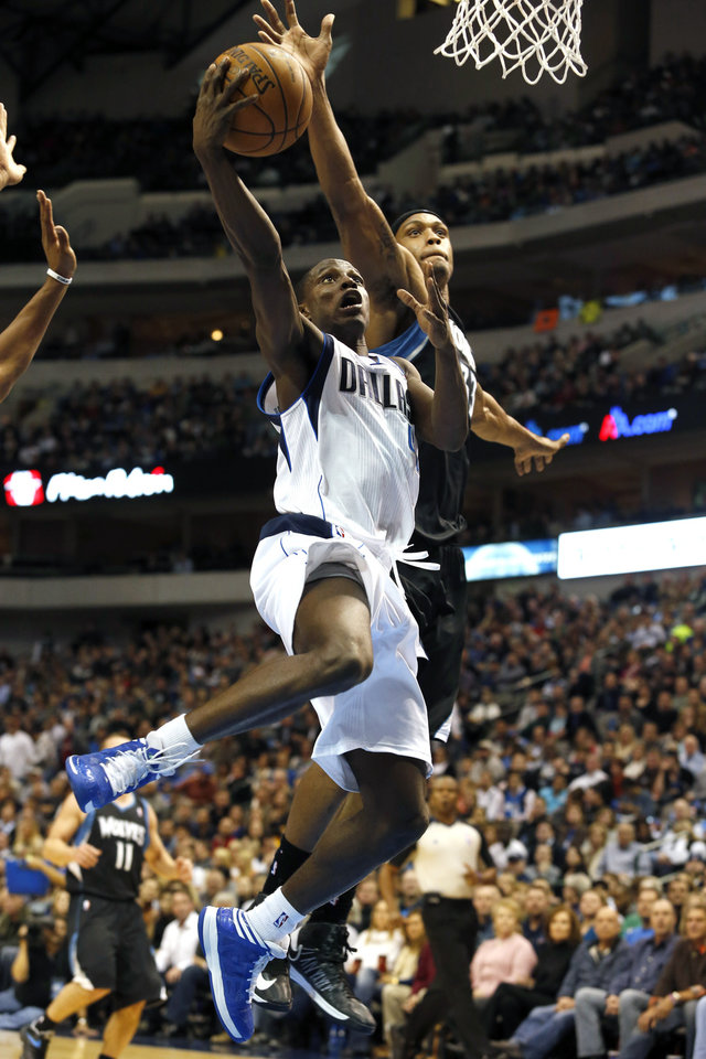 Photo - Dallas Mavericks guard Darren Collison (4) shoots as Minnesota Timberwolves forward Dante Cunningham (33) defends during the first half of an NBA basketball game, Monday, Jan. 14, 2013, in Dallas. (AP Photo/Sharon Ellman)