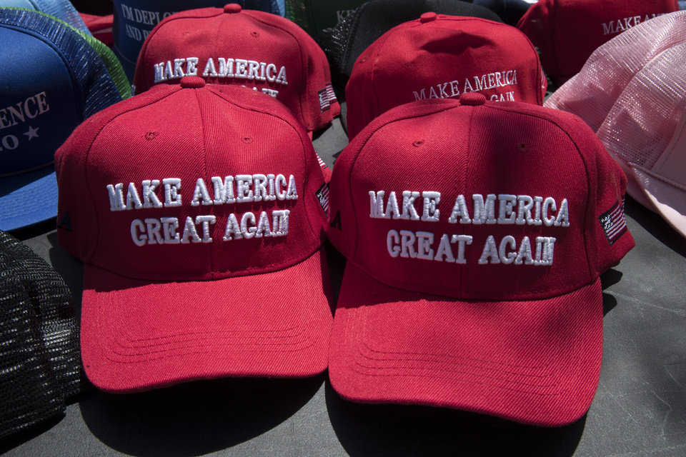 Photo -  Make America Great Again hats ahead of a President Donald Trump campaign rally in Montoursville, Pa., Monday, May 20, 2019. [AP Photo/Matt Rourke]