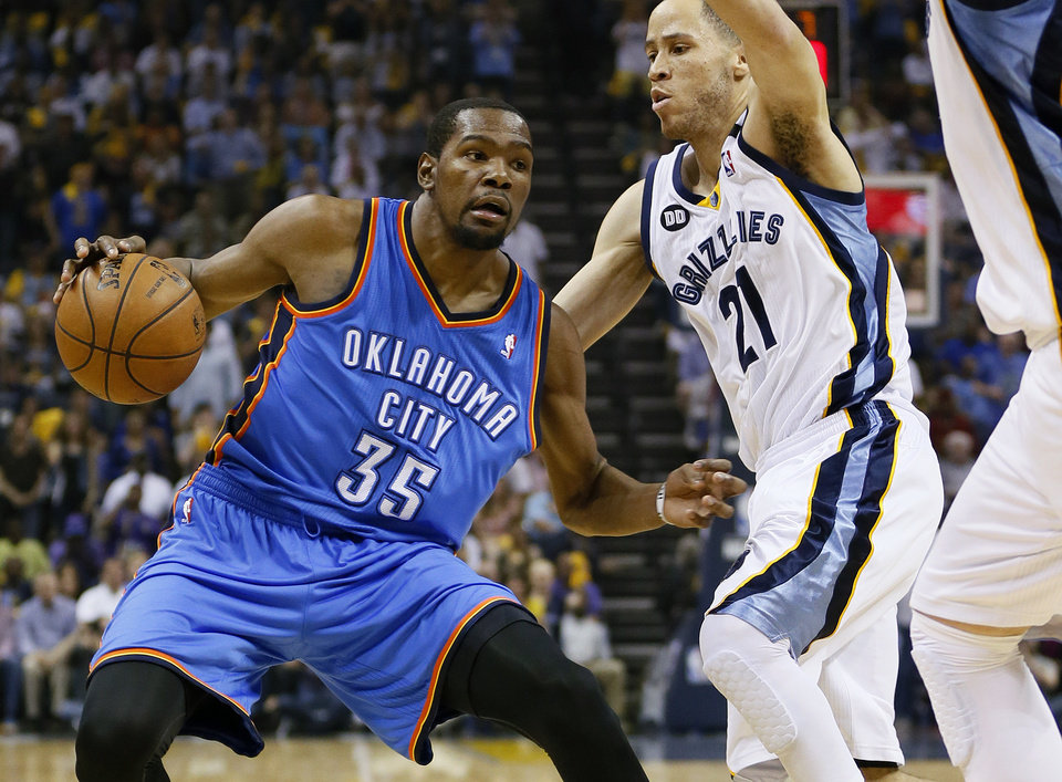 Photo - Oklahoma City's Kevin Durant (35) tries to get past Memphis' Tayshaun Prince (21) during Game 4 of the second-round NBA basketball playoff series between the Oklahoma City Thunder and the Memphis Grizzlies at FedExForum in Memphis, Tenn., Monday, May 13, 2013. Photo by Nate Billings, The Oklahoman