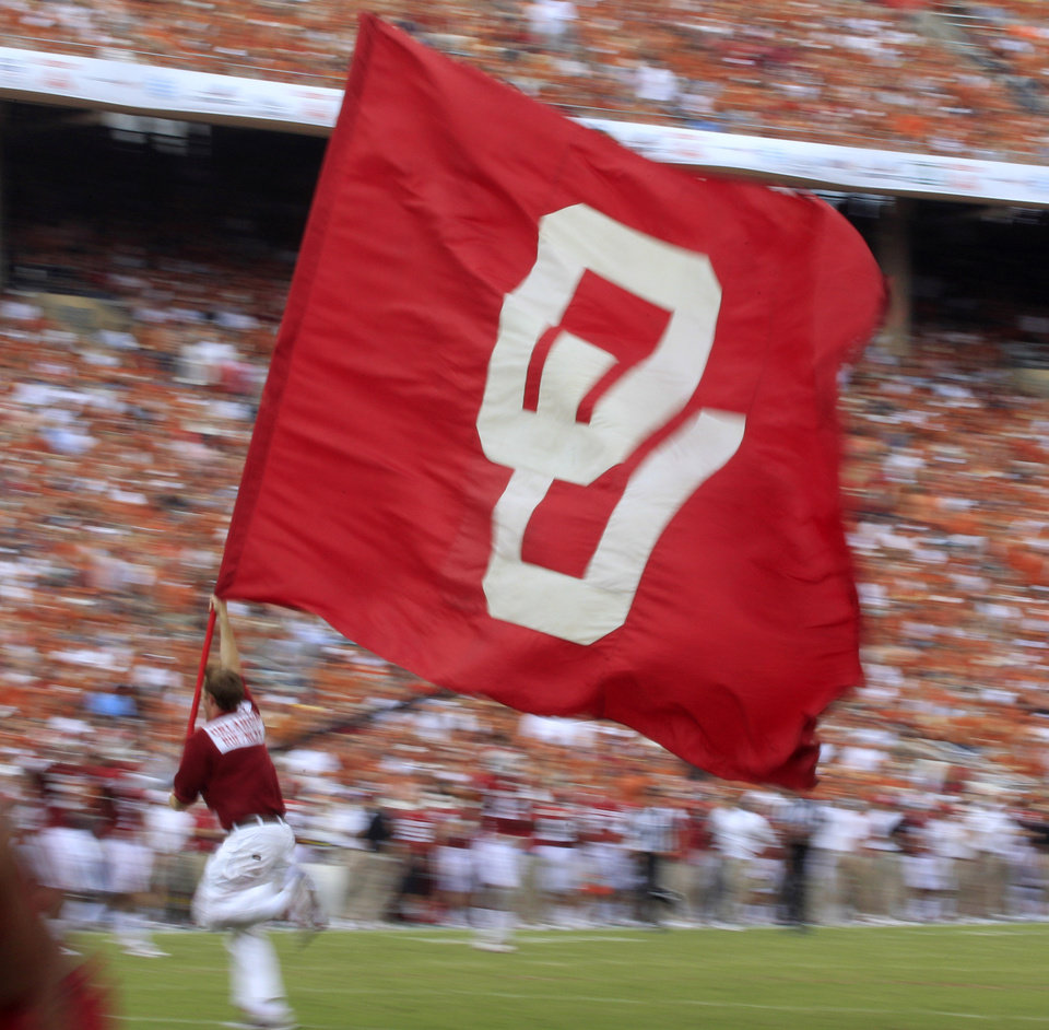Photo -   An Oklahoma flag is carried across the field after a touchdown was scored during the first half of an NCAA college football game against the Texas at the Cotton Bowl Saturday, Oct. 13, 2012, in Dallas. (AP Photo/LM Otero)
