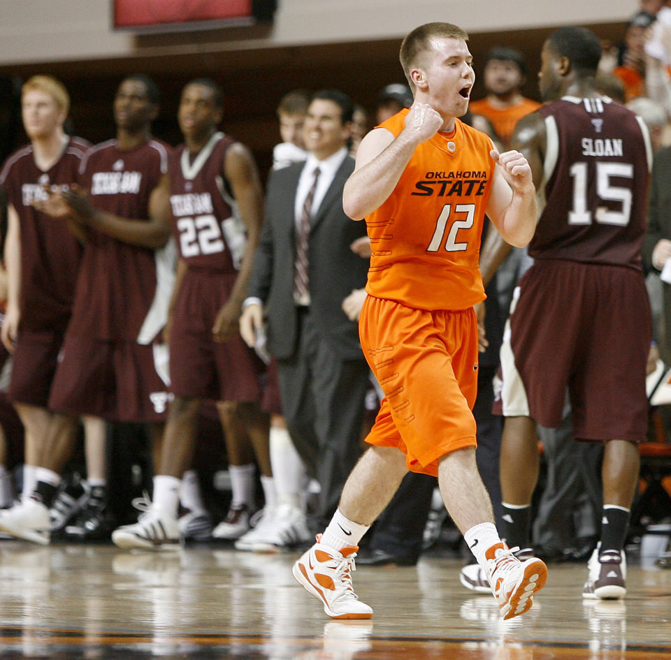 Photo - OSU's Keiton Page celebrates during an NCAA college basketball game between the Oklahoma State University and Texas A&M at Gallagher-Iba Arena in Stillwater, Okla., Wednesday, January 27, 2010. Photo by Bryan Terry, The Oklahoman
