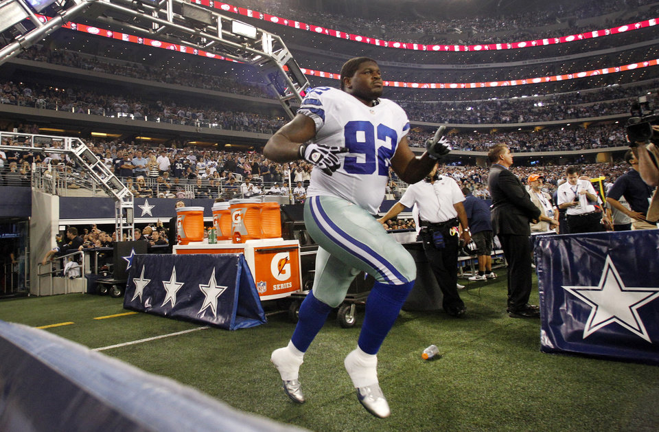 In this Sunday, Dec. 2, 2012, photo, Dallas Cowboys nose tackle Josh Brent runs onto the field out of the team\'s tunnel after being introduced before an NFL football game against the Philadelphia Eagles in Arlington, Texas. Brent is facing an intoxication manslaughter charge after a one-vehicle accident that killed linebacker Jerry Brown, a member of the team\'s practice squad. (AP Photo/Tony Gutierrez)