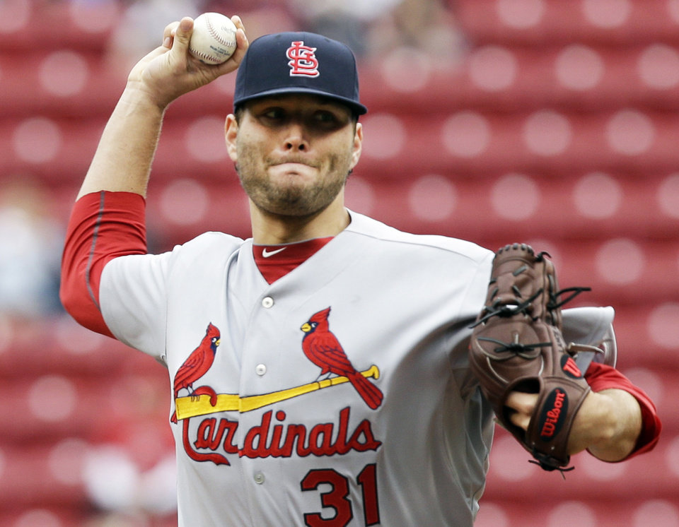 Photo - St. Louis Cardinals starting pitcher Lance Lynn throws against the Cincinnati Reds in the first inning of a baseball game, Thursday, April 3, 2014, in Cincinnati. (AP Photo/Al Behrman)