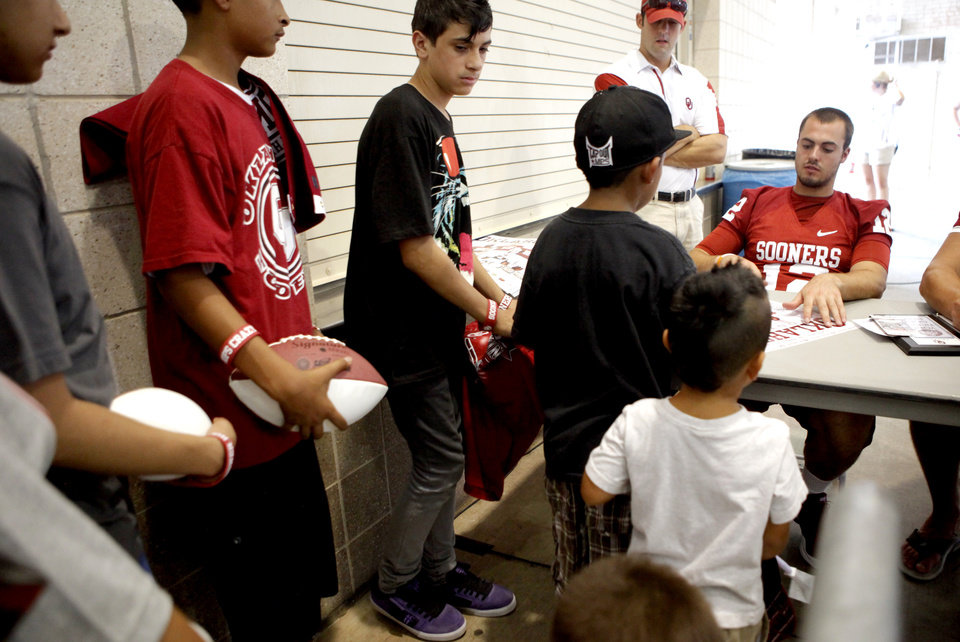 Photo - Fans wait in line for OU's Landry Jones during the University of Oklahoma's Meet the Sooners Day at Gaylord Family-Oklahoma Memorial Stadium in Norman, Okla., Saturday, August 6, 2011. Photo by Bryan Terry, The Oklahoman