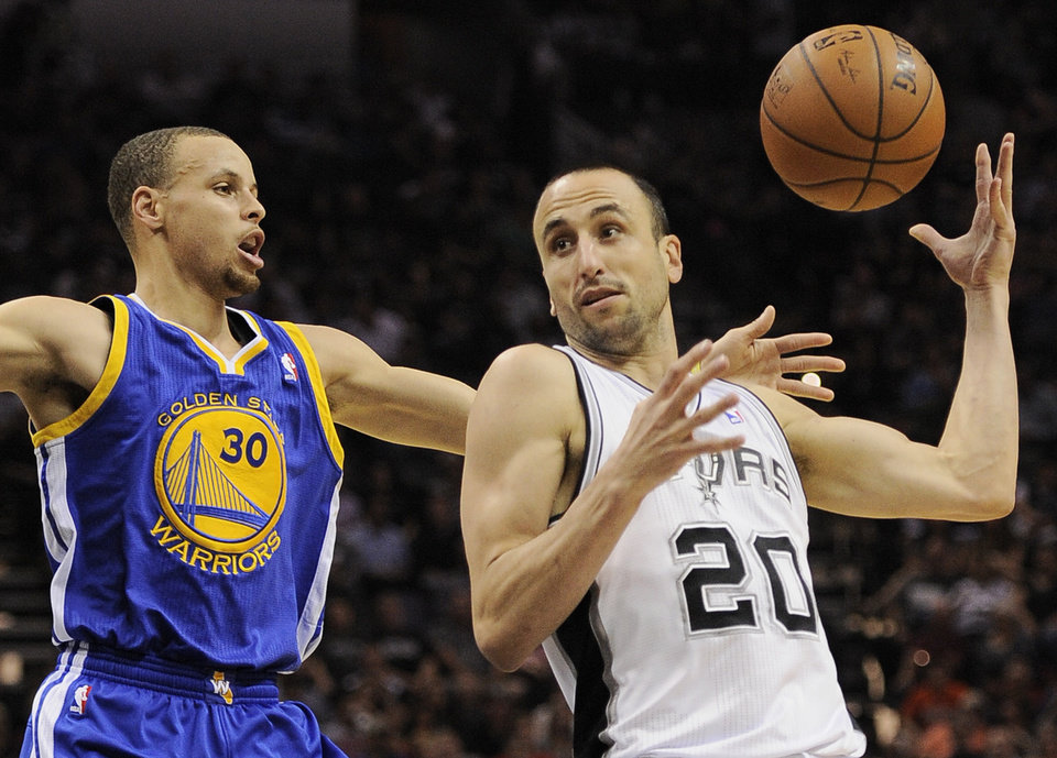 Photo - San Antonio Spurs guard Manu Ginobili, right, of Argentina, drives around Golden State Warriors guard Stephen Curry during the first half of an NBA basketball game on Wednesday, April 2, 2014, in San Antonio. (AP Photo/Darren Abate)
