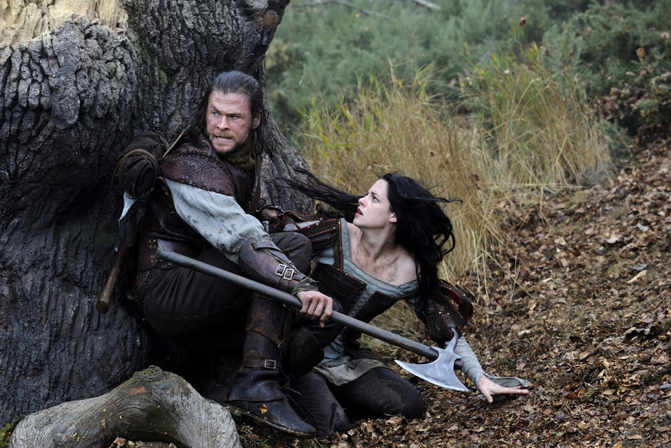 "From left, Chris Hemsworth and Kristen Stewart appear in a scene from ""Snow White and the Huntsman."" Universal Pictures photo <strong></strong>"