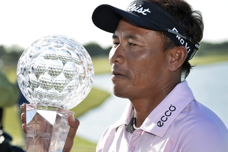 Photo - Thongchai Jaidee of Thailand poses with his trophy after winning the Nordea Masters at PGA National, Malmo, Sweden, Sunday June 1, 2014. (AP Photo/Anders Wiklund, TT News Agency)        SWEDEN OUT