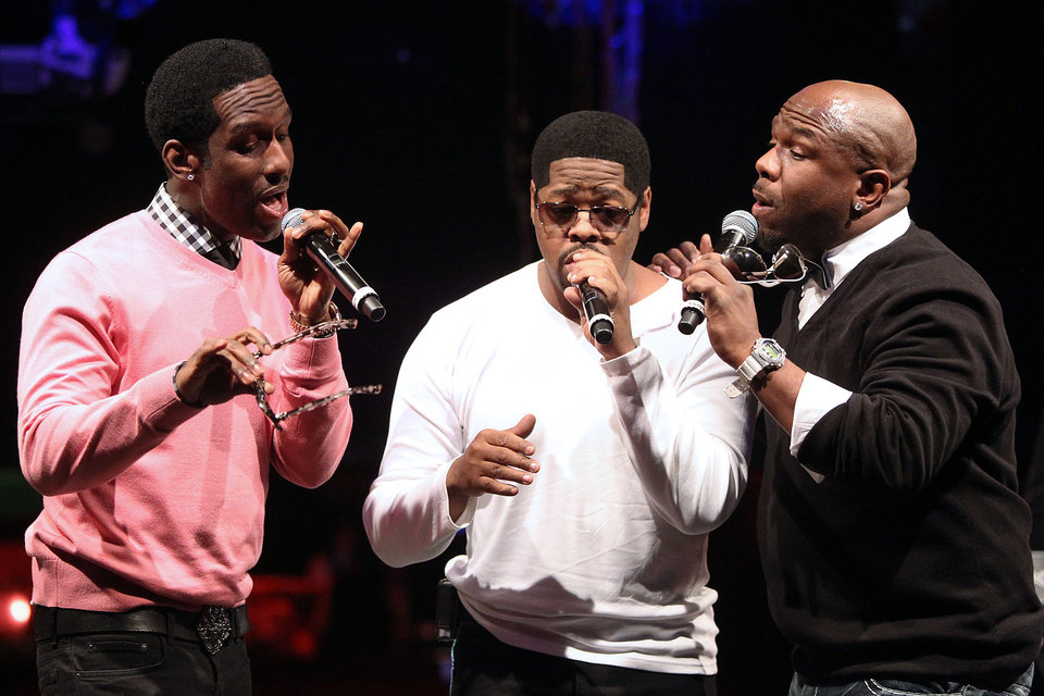 In this picture provided by Starpix, from left, Shawn Stockman, Nathan Morris, Wanya Morris of Boyz II Men perform during the announcement of