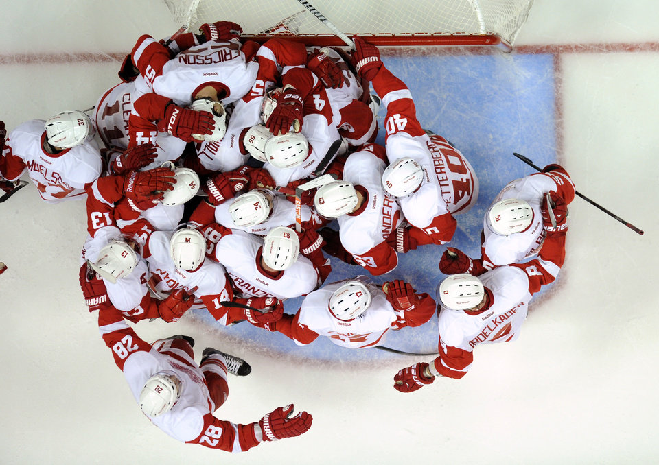 Photo - The Detroit Red Wings celebrate their 3-2 win over the Anaheim Ducks in Game 7 of their first-round NHL hockey Stanley Cup playoff series in Anaheim, Calif., Sunday, May 12, 2013. (AP Photo/Chris Carlson)
