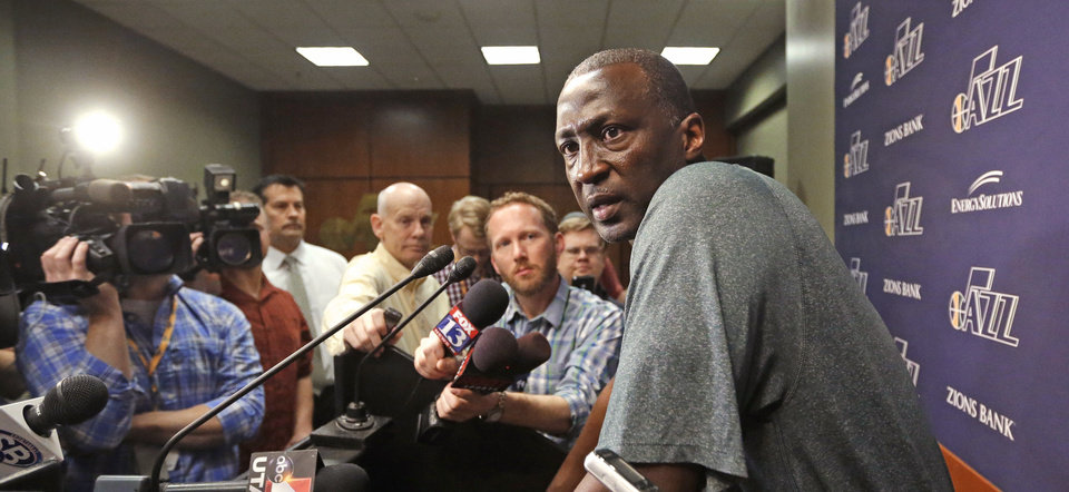 Photo - Utah Jazz coach Tyrone Corbin speaks to the media on the day the Jazz cleaned out their lockers after a 25-57 season, Thursday, April 17, 2014, in Salt Lake City. (AP Photo/Rick Bowmer)