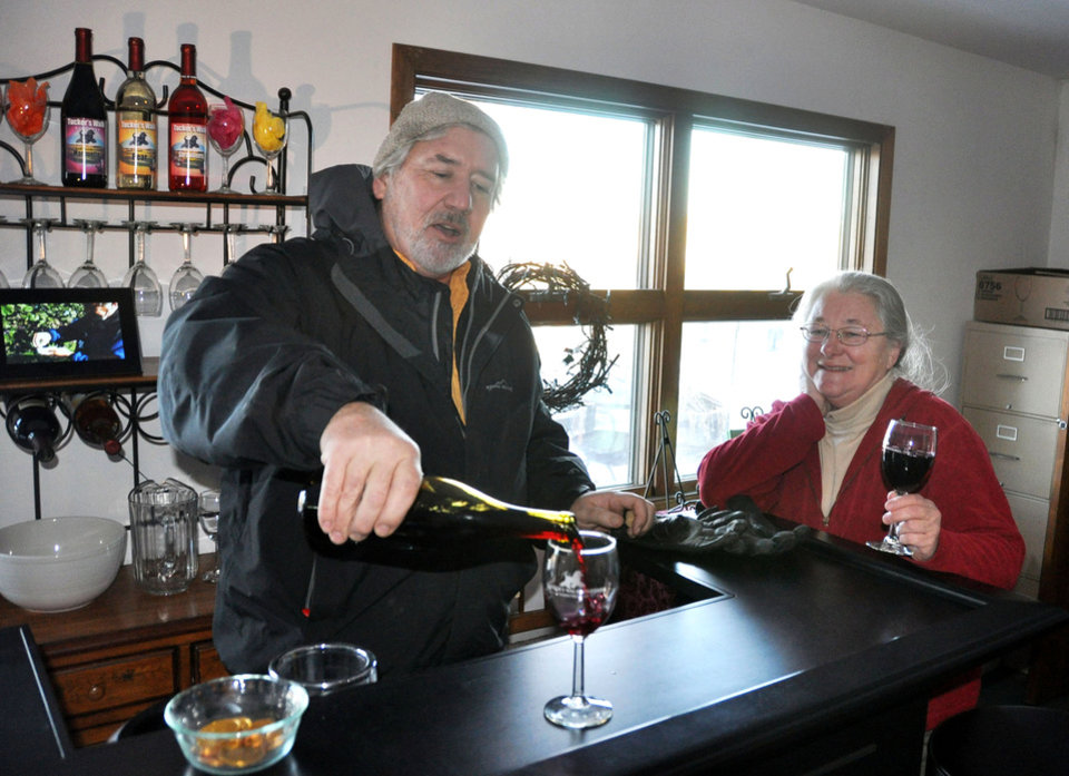 In this Feb. 9, 2012, photo Dave Greenlee pours a glass of a 2011 Marquette nearly ready for bottling at Tucker's Walk Vineyard run by he and his wife, Sue, in Garretson, S.D. A $2.5 million U.S. Department of Agriculture grant is helping university researchers from across a dozen northern-tier states help winemakers and grape growers such as the Greenlees share expertise and develop their markets. (AP Photo/Dirk Lammers)
