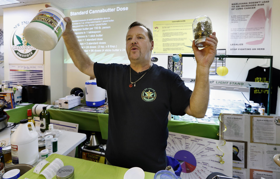 Photo - In this Thursday, July 10, 2014, photo, Mike Fitzgerald discusses how to prepare a cannabis-infused cooking oil during a cooking class at the New England Grass Roots Institute in Quincy, Mass. For many sick people, especially those with cancer, smoking marijuana is not a safe option, and some edibles can deliver a longer-lasting therapeutic dose that doesn't give them a buzz. (AP Photo/Michael Dwyer)