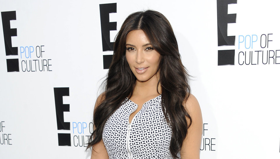 Photo -   FILE - In this April 30, 2012 file photo, Kim Kardashian from the show