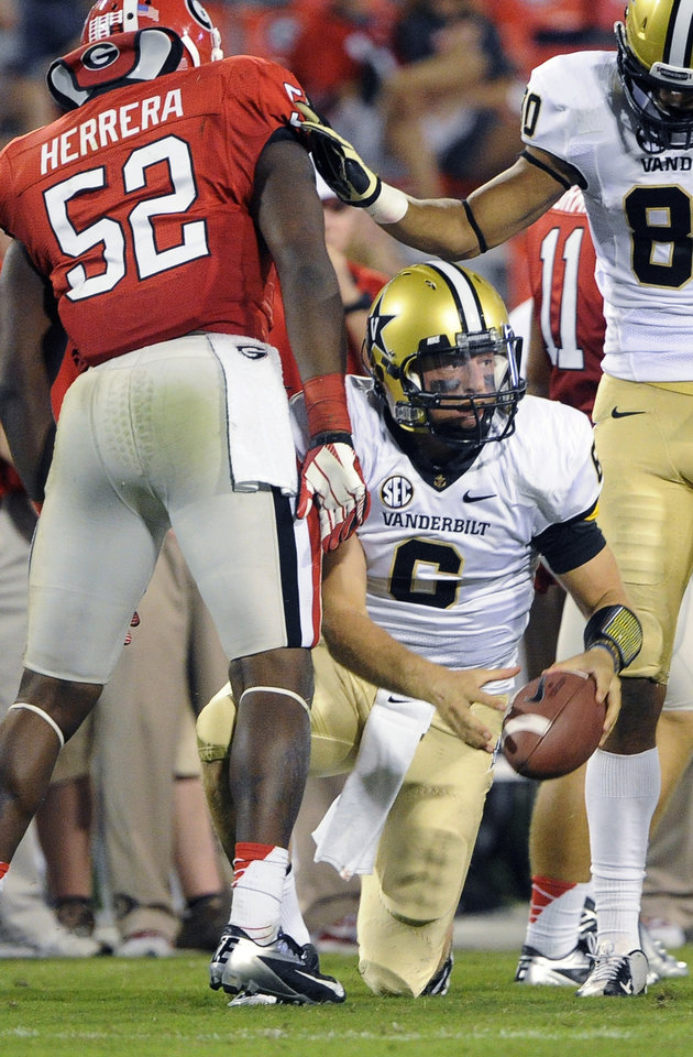 Photo -   Vanderbilt quarterback Austyn Carta-Samuels (6) gets up after being brought down for a loss by Georgia linebacker Amarlo Herrera (52) during the fourth quarter of an NCAA college football game, Saturday, Sept. 22, 2012, in Athens, Ga. (AP photo/John Amis)