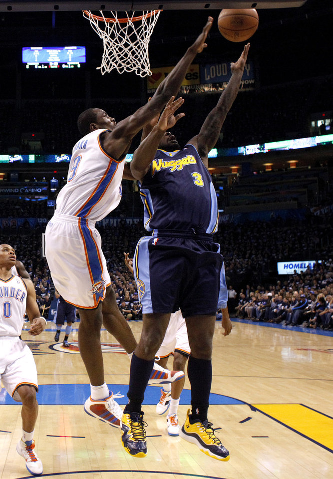 Photo - Oklahoma City's Serge Ibaka (9) blocks Denver's Ty Lawson's (3) layup during the NBA basketball game between the Denver Nuggets and the Oklahoma City Thunder in the first round of the NBA playoffs at the Oklahoma City Arena, Wednesday, April 27, 2011. Photo by Sarah Phipps, The Oklahoman