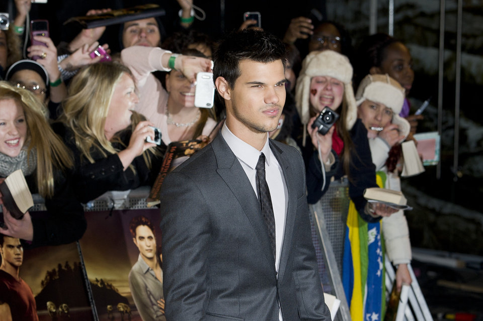 US actor Taylor Lautner arrives for the UK premiere of 'Twilight Breaking Dawn Part 1' at a central London venue,  Wednesday, Nov. 16, 2011. (AP Photo/Jonathan Short) ORG XMIT: LJS109