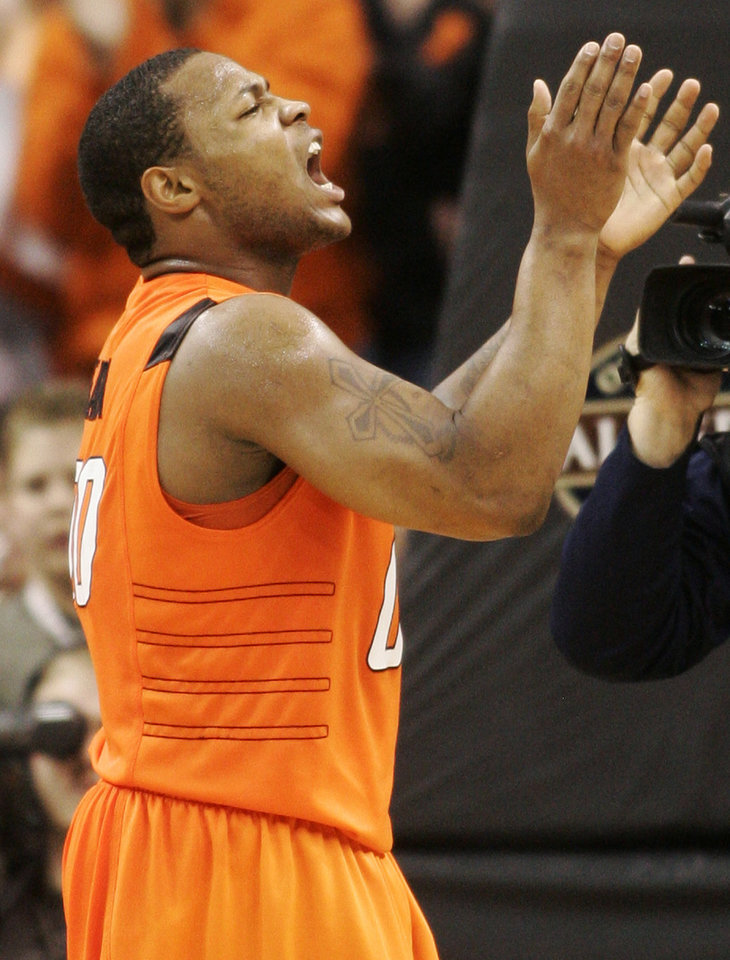 Photo - Oklahoma State guard Byron Eaton reacts as Oklahoma State defeated Rhode Island 86-82 in an NCAA college basketball game in Oklahoma City, Saturday, Dec. 20, 2008. (AP Photo/Sue Ogrocki) ORG XMIT: OKSO107
