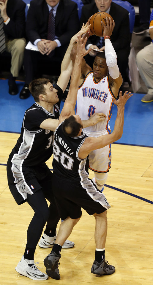 Photo - San Antonio's Aron Baynes (16) and Manu Ginobili (20) defend against Oklahoma City's Russell Westbrook (0) during Game 3 of the Western Conference Finals in the NBA playoffs between the Oklahoma City Thunder and the San Antonio Spurs at Chesapeake Energy Arena in Oklahoma City, Sunday, May 25, 2014. Photo by Nate Billings, The Oklahoman