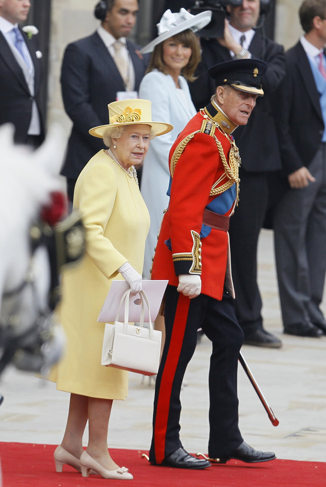 Photo - Britain's Queen Elizabeth II  and Britain's Prince Philip leave after the wedding service at Westminster Abbey at the Royal Wedding in London Friday, April 29, 2011. (AP Photo/Alastair Grant)  ORG XMIT: RWFO198