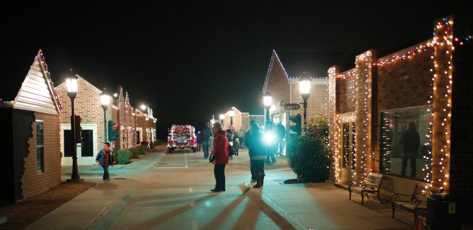 Photo -  Families check out the Edmond Fire Department's Children's Safety Village during Winter Night. PHOTO BY DOUG HOKE, THE OKLAHOMAN   DOUG HOKE -