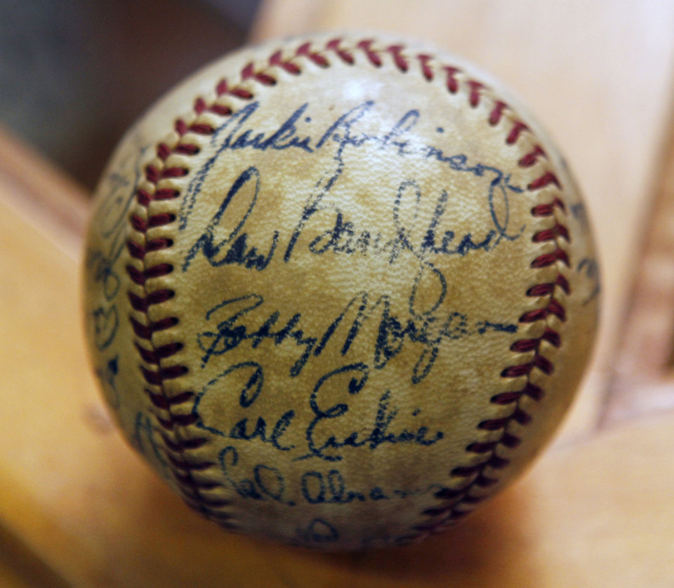 Photo - BASEBALL COLLECTION: JACKIE ROBINSON: This is one of the items in a collection of autographed baseballs on display at the Oklahoma Sports Hall of Fame in Guthrie, OK, Thursday, April 11, 2013,  By Paul Hellstern, The Oklahoman