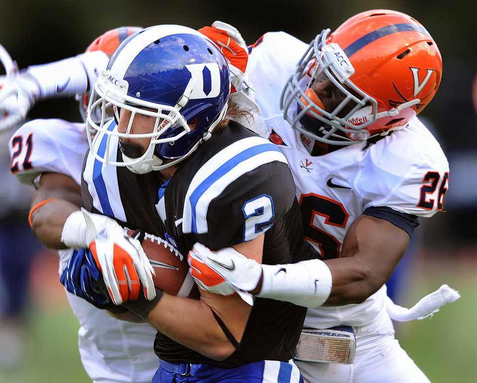 Photo -   Duke's Conner Vernon score a touchdown past Virginia's Brandon Phelps (21) and Maurice Canady (26) during an NCAA college football game Saturday, Oct. 6, 2012, in Durham, N.C. (AP Photo/The Herald-Sun, Bernard Thomas)
