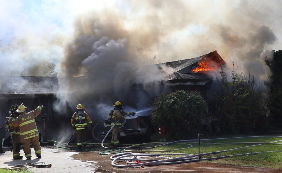 Photo -  House fire in the 3300 block of Longridge Rd. in Del City, Monday, October 7, 2019. [Doug Hoke/The Oklahoman]