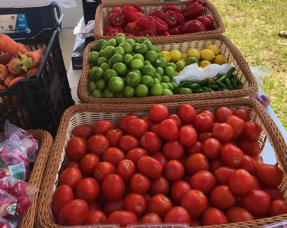 Photo - Fresh produce was on sale Tuesday at the Cultivar Mexican Kitchen street market in northwest Oklahoma City. [Dave Cathey/The Oklahoman]