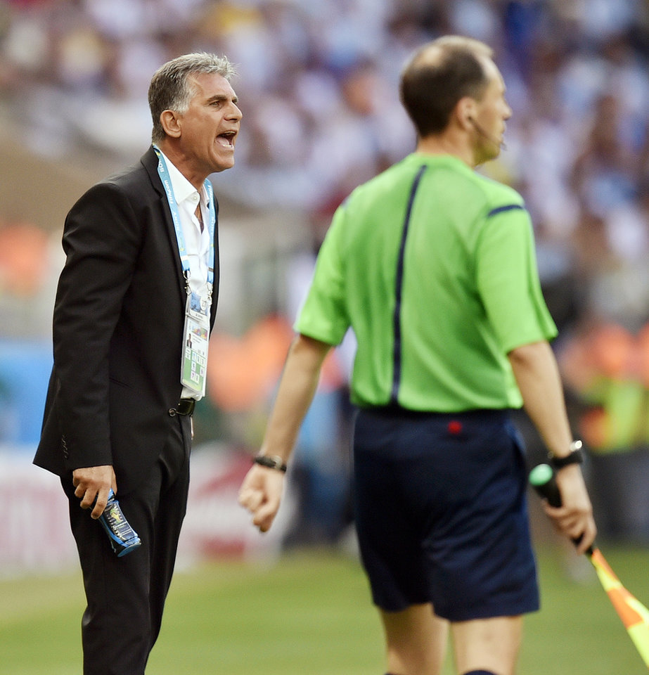 Photo - Iran's head coach Carlos Queiroz gives directions to his players during the group F World Cup soccer match between Argentina and Iran at the Mineirao Stadium in Belo Horizonte, Brazil, Saturday, June 21, 2014. (AP Photo/Martin Meissner)