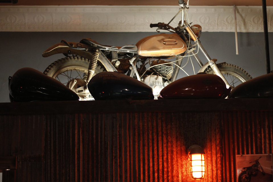 A motorcycle serves as a decoration at Grandad's Bar, 317 NW 23. Photo by Doug Hoke, The Oklahoman <strong>DOUG HOKE</strong>
