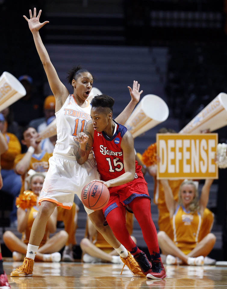 Photo - St. John's guard Danaejah Grant (15) drives against Tennessee forward Cierra Burdick (11) in the first half of an NCAA women's college basketball second-round tournament game Monday, March 24, 2014, in Knoxville, Tenn. (AP Photo/John Bazemore)