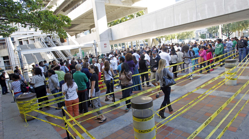 Photo -   South Floridians stand in line during the last day of early voting in Miami, Saturday, Nov. 3, 2012. Despite record turnout in many parts of the state, Florida Gov. Rick Scott rejected calls to extend early voting through Sunday to help alleviate long lines at the polls. (AP Photo/Alan Diaz)
