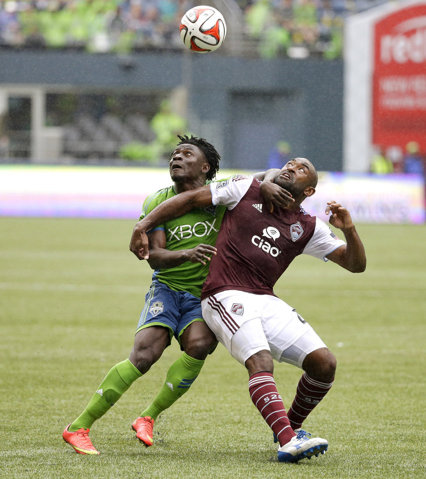 Photo - Seattle Sounders' Obafemi Martins, left, and Colorado Rapids' Marvell Wynne, right, battle for a header during the second half of an MLS soccer match, Saturday, Aug. 30, 2014, in Seattle. The Sounders won 1-0. (AP Photo/Ted S. Warren)