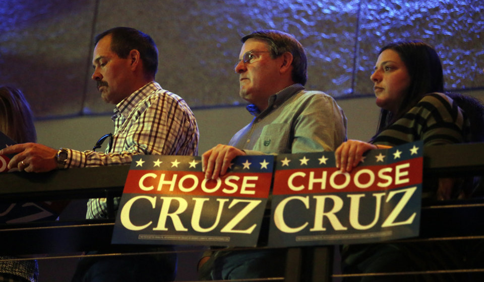 Photo - Supporters stand at an upstairs railing as Republican presidential candidate Ted Cruz speaks at the Chevy Bricktown Event Center as part of the Oklahoma City Courageous Conservatives Rally on Sunday, Feb. 28, 2016 in Oklahoma City, Okla.  Photo by Steve Sisney, The Oklahoman