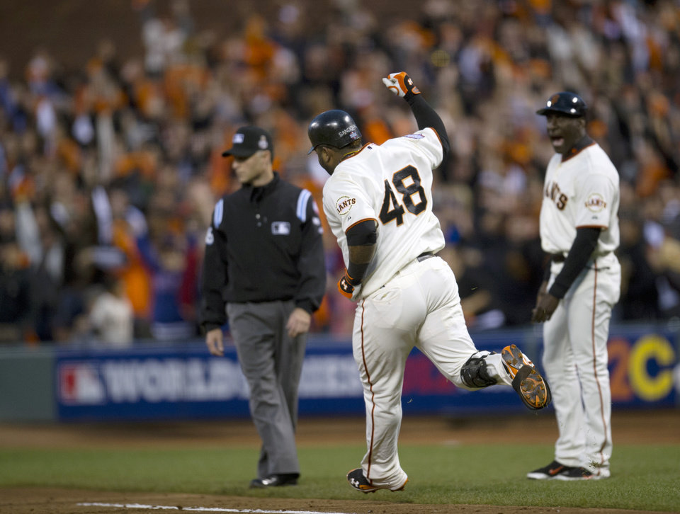 Photo -   San Francisco Giants' Pablo Sandoval (48) approaches first base after hitting his second home run, as Giants first base coach Roberto Kelly (39) watches during Game 1 of the World Series between the Giants and the Detroit Tigers, Wednesday, Oct. 24, 2012, in San Francisco. (AP Photo/The Sacramento Bee, Paul Kitagaki Jr.) MAGS OUT; TV OUT (KCRA3, KXTV10, KOVR13, KUVS19, KMAZ31, KTXL40) MANDATORY CREDIT