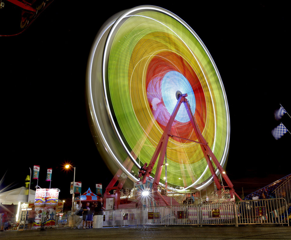The Ferris wheel spins Wednesday at the Oklahoma State Fair in Oklahoma City. Photo by Bryan Terry, The Oklahoman  <strong>BRYAN TERRY</strong>