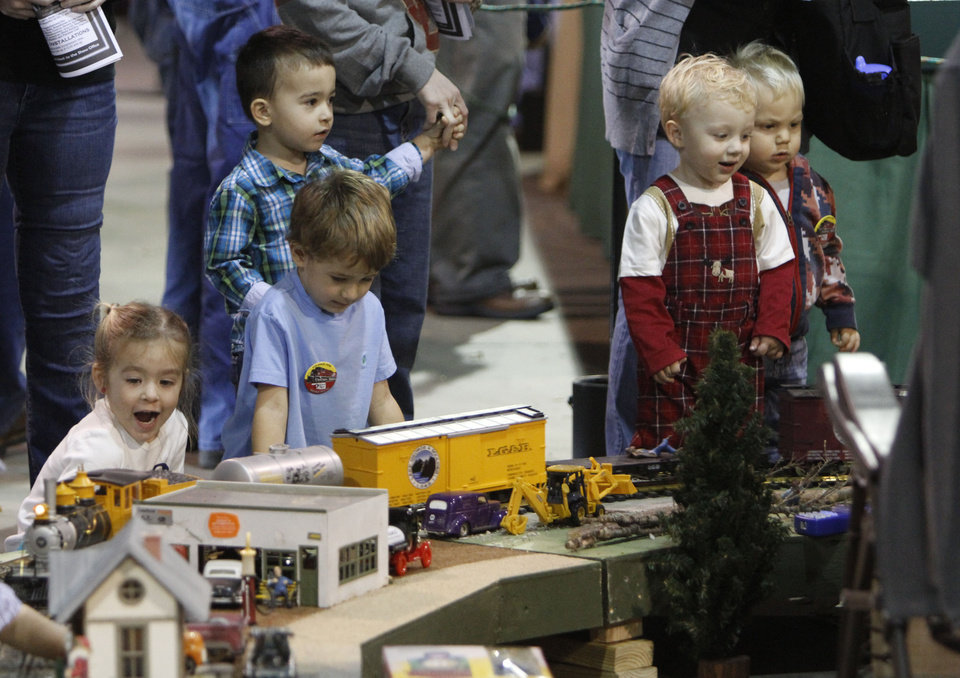 Photo - Children watch trains go down a track during the OKC Train Show at State Fair Park in Oklahoma City, OK, Saturday, December 1, 2012,  By Paul Hellstern, The Oklahoman