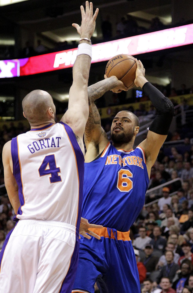 New York Knicks' Tyson Chandler (6) shoots over Phoenix Suns' Marcin Gortat, of Poland, during the first half of an NBA basketball game on Wednesday, Dec. 26, 2012, in Phoenix. (AP Photo/Matt York)