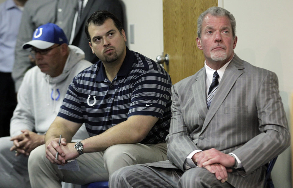 Indianapolis Colts owner Jim Irsay, right, general manager Ryan Grigson, center, and interim head coach Bruce Arians listen as a doctor talks about head coach Chuck Pagano, who has been diagnosed with acute promyelocytic leukemia, during an NFL football news conference at the team\'s headquarters in Indianapolis, Monday, Oct. 1, 2012. (AP Photo/Michael Conroy)