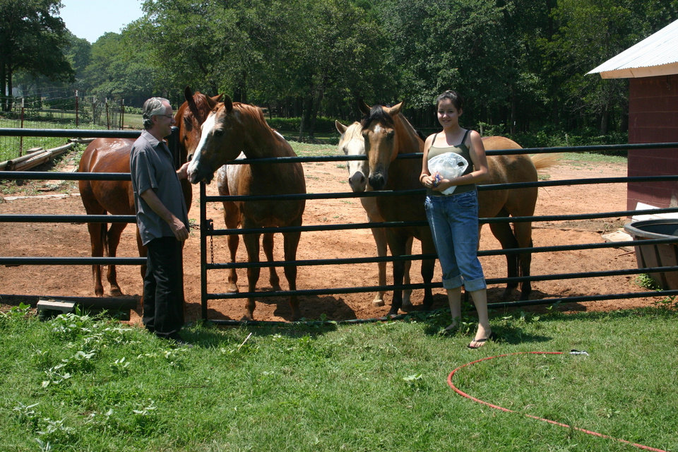 My Buddy Bob and his daughter Missy getting some attention from some of our horses<br/><b>Community Photo By:</b> Dan Bradley<br/><b>Submitted By:</b> Dan, Harrah