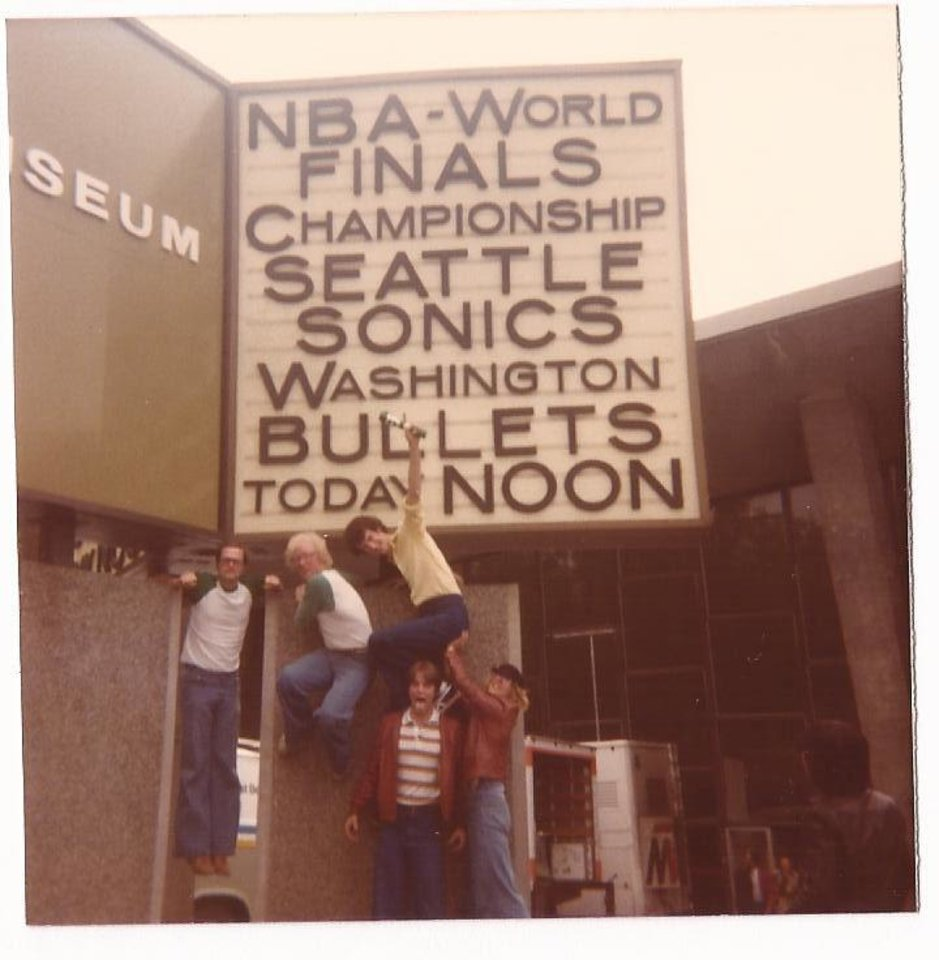 Photo - Michael Wilcox and friends celebrate during the 1978 NBA Finals between the Seattle SuperSonics and the Washington Bullets.  PHOTO PROVIDED