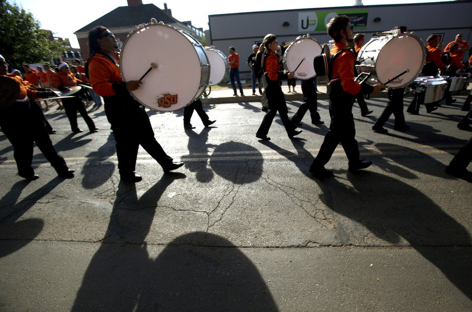 Photo - The OSU band preforms during the Spirit Walk before the  game between Oklahoma State and Arizona on Thursday at Boone Pickens Stadium in Stillwater. PHOTO BY BRYAN TERRY, The Oklahoman