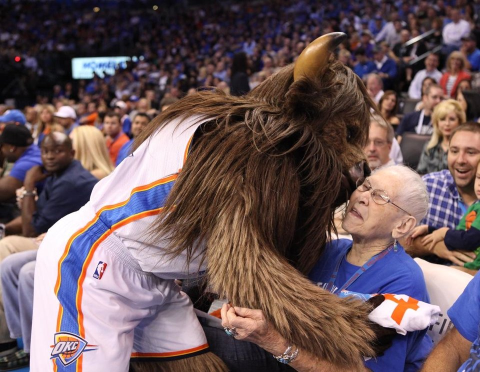 Photo - Leola Boyd, the OKC Thunder fan who had hoped to raise money to keep James Harden in Oklahoma City meets Rumble the Bison at the OKC Thunder's home opener on Friday, Nov. 2 in Chesapeake Energy Arena in Oklahoma City, Okla.       Here's the story from the evening from Berry Tramel.