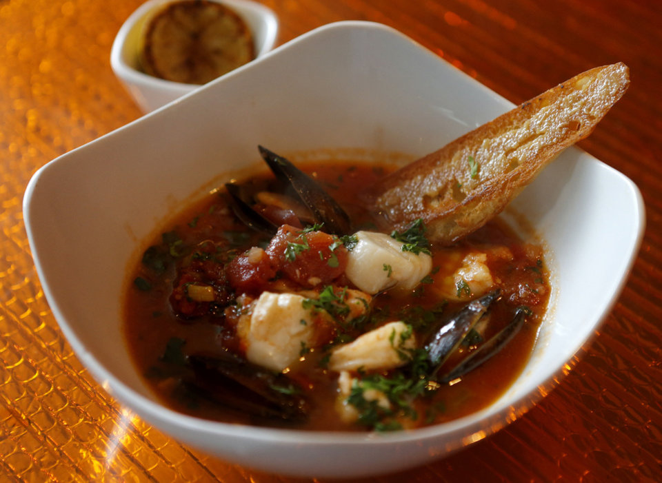 Photo - Cioppino seafood stew is shown at the Saturn Grill's newest location is in Oklahoma City's Midtown. Photo by Bryan Terry, The Oklahoman  Bryan Terry - THE OKLAHOMAN