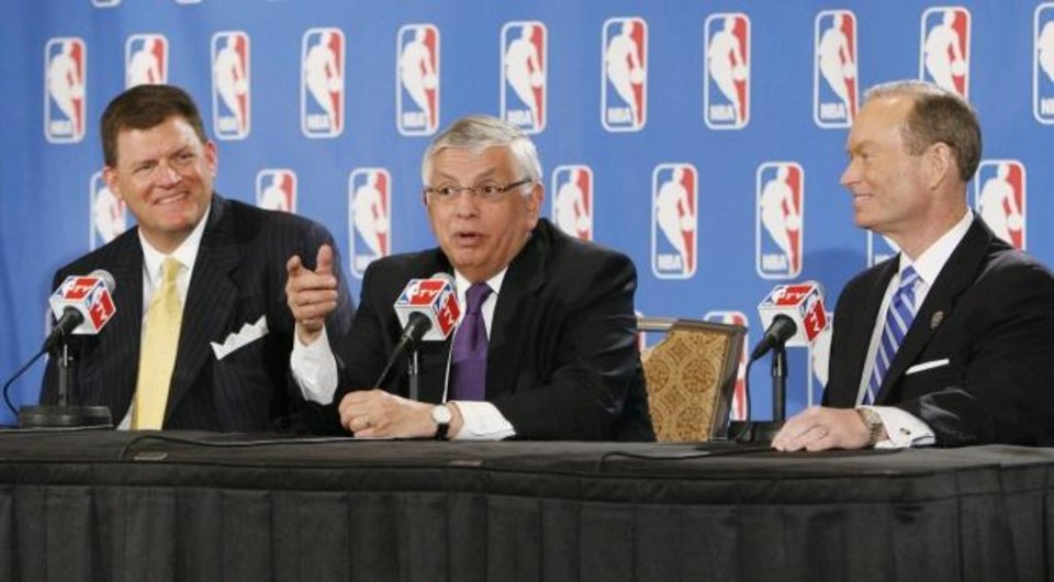 Photo -  Thunder chairman Clay Bennett, left, and then-Oklahoma City mayor Mick Cornett, right, listen to NBA commissioner David Stern during a news conference at the Skirvin Hilton on March 25, 2008.  [NATE BILLINGS/THE OKLAHOMAN]