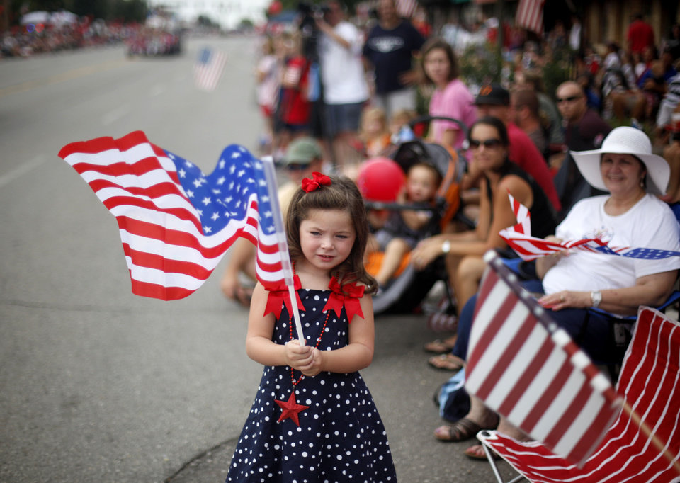 Photo - Lauryn Lackey, 5, watches the LibertyFest Parade in Edmond, Okla., Monday, July 4, 2011. Photo by Sarah Phipps, The Oklahoman