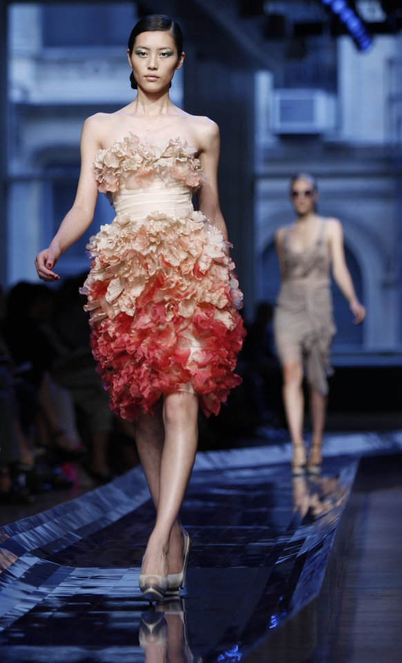 Photo -  Fashion from Jason Wu Spring 2011 collection is modeled Friday Sept. 10, 2010, during Fashion Week in New York. (AP Photo/Bebeto Matthews) ORG XMIT: NYBM323
